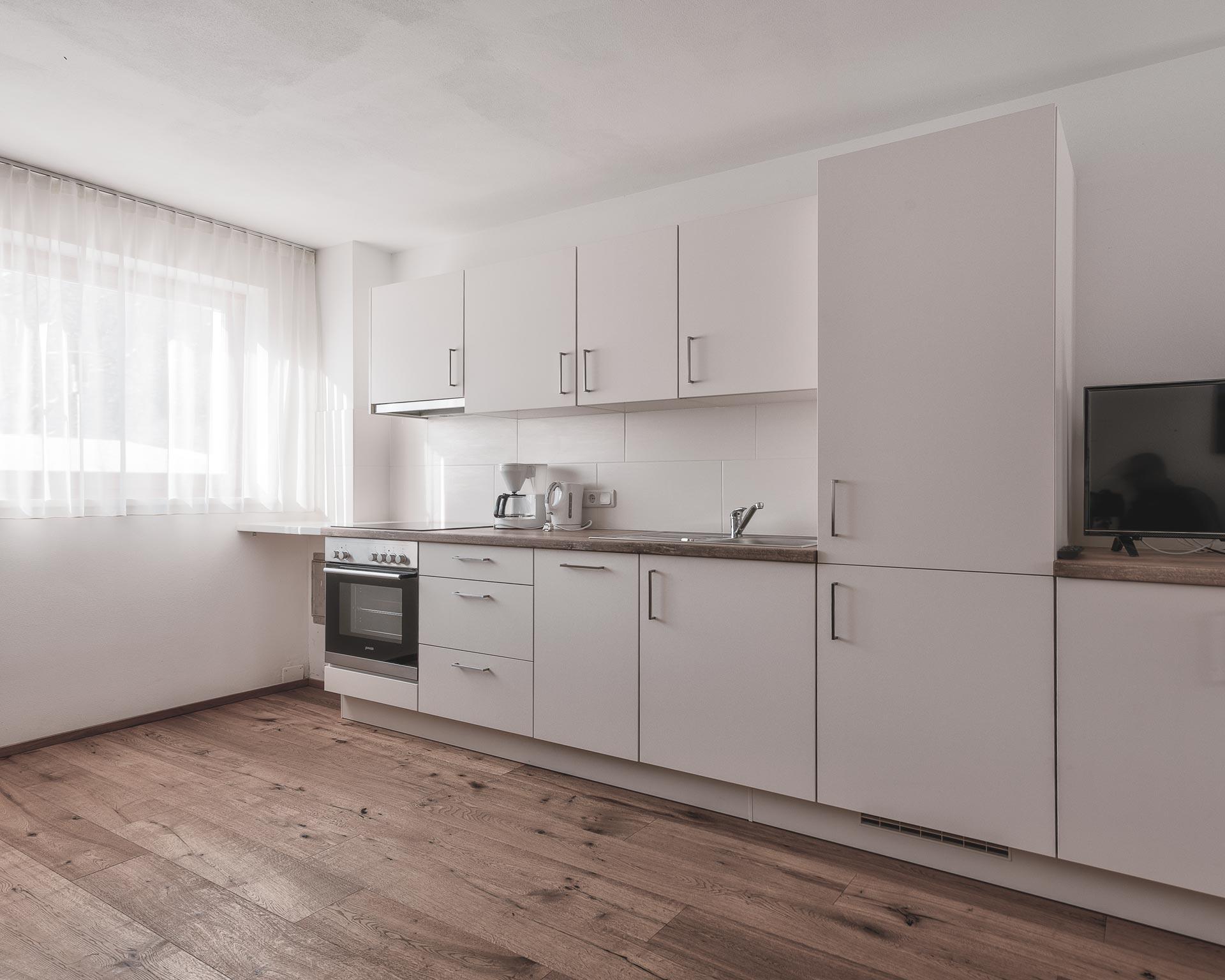chalet waldblick2 wohnkueche appartements pfarrwirt sand in taufers